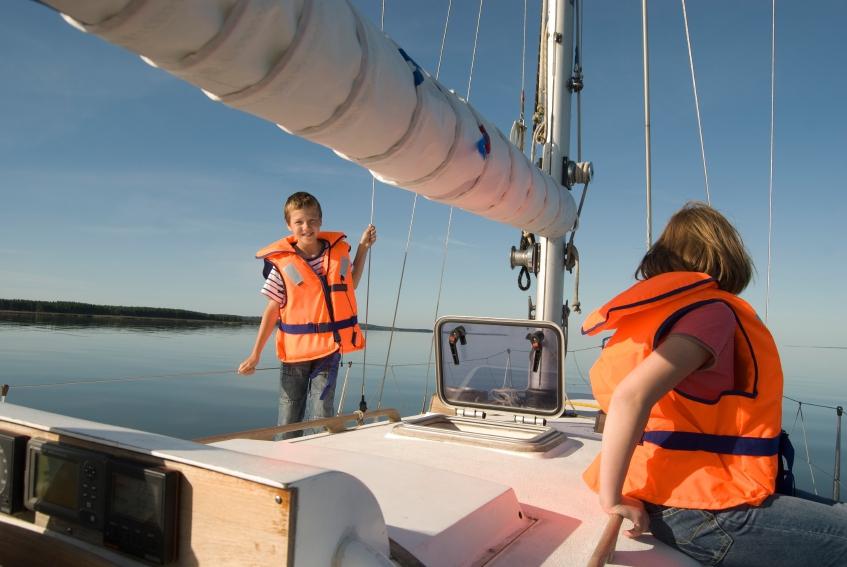 Kids sailing on a yacht
