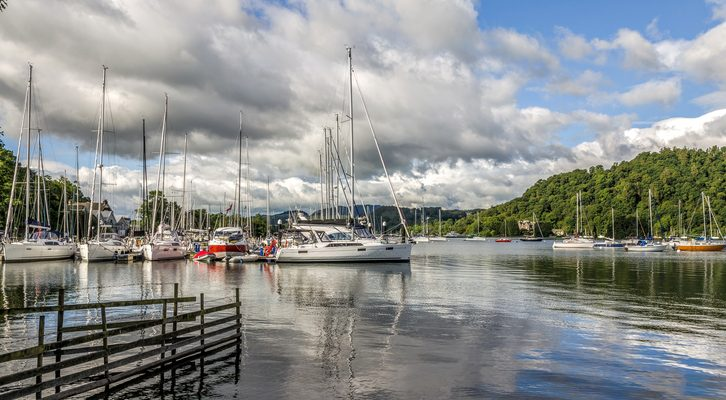 Sailboats in harbor at Windermere at Bowness on sunny day.