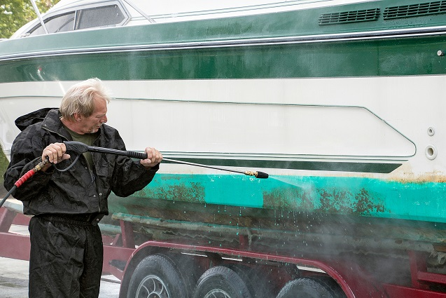 using a power hose on a dirty boat