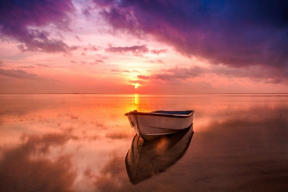 gorgeous sunset boat on still waters