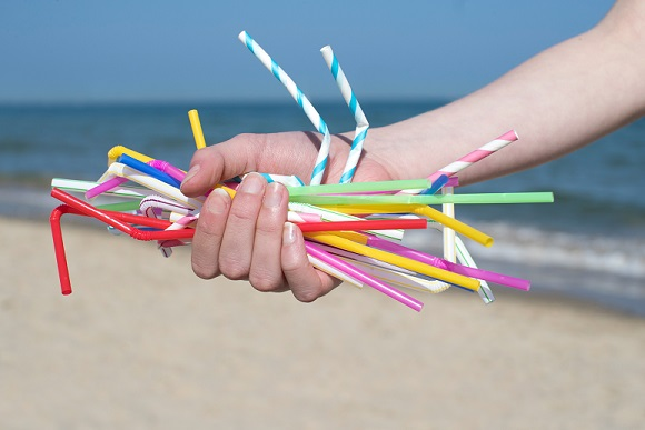 handful of bad plastic straws on the beach
