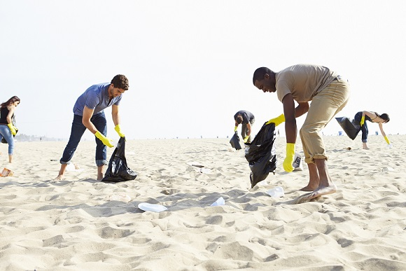 volunteers picking up plastic from beach