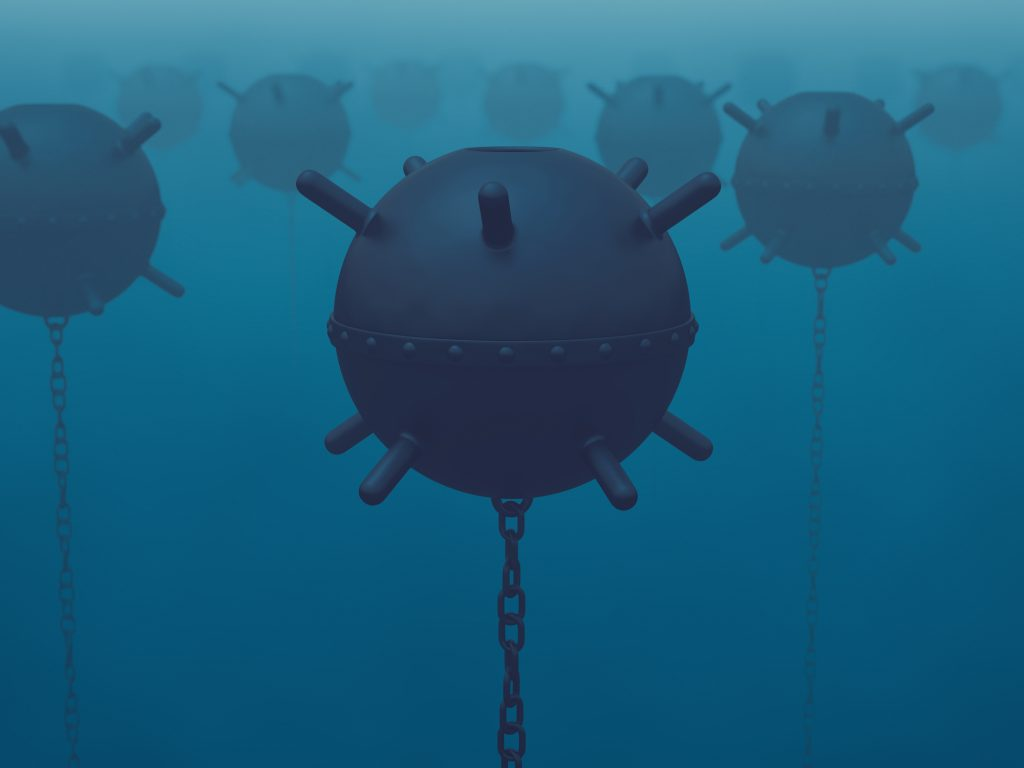 A field of naval mines in the sea (latent threat)